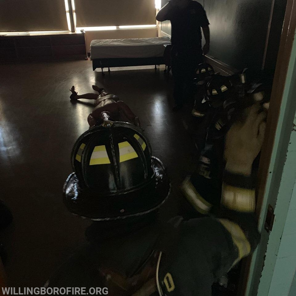 Entering a dark room with their SCBA mask covered